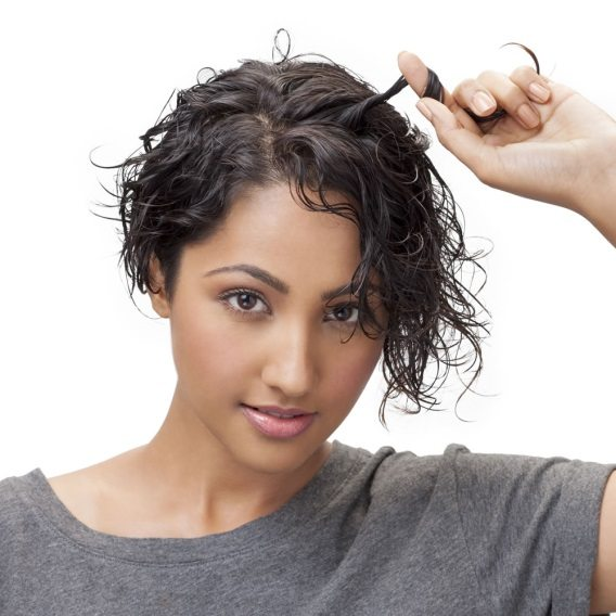 Step 2 Take random sections of your hair and twist them around your finger to enhance the curl movement and defined curls. Your curls define you, so go ahead and give them some love