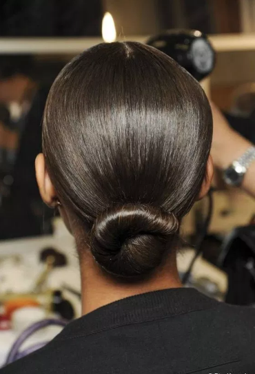 twisted and sleek low bun