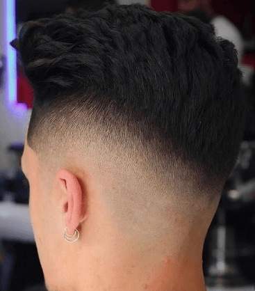 fauxhawk hairstyle for men with fade texture