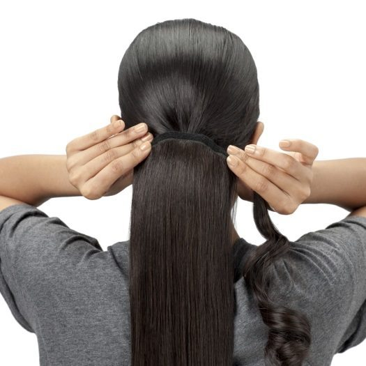 Step 2 Place the hair extension onto your natural hair ponytail, and use the comb attached to the extension to secure it into place. You can use U-pins or bobby pins for extra hold and security.