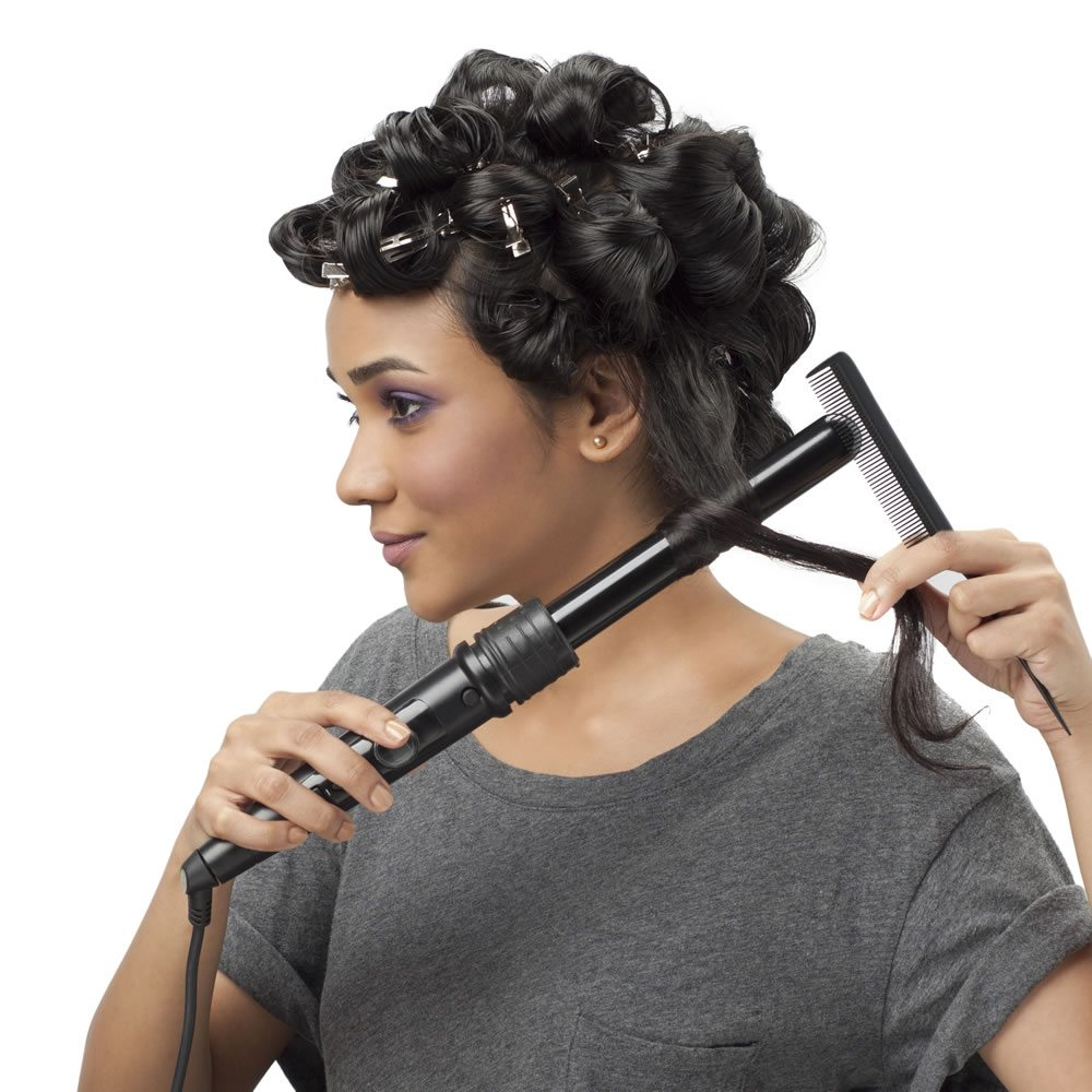 Step 4 - Use BBLUNT's X3 Professional Curling Wand to create the soft wave effect seen here. Choose the large sized barrel, because the bigger the barrel, the better the waves! Wind your hair around the curling wand and hold it in place for a while. Clip the hair into place and allow your waves to cool before opening them out. Dress them into place using your fingers. You could also spray on BBLUNT's Spotlight Hair Polish for a glossy finished look!