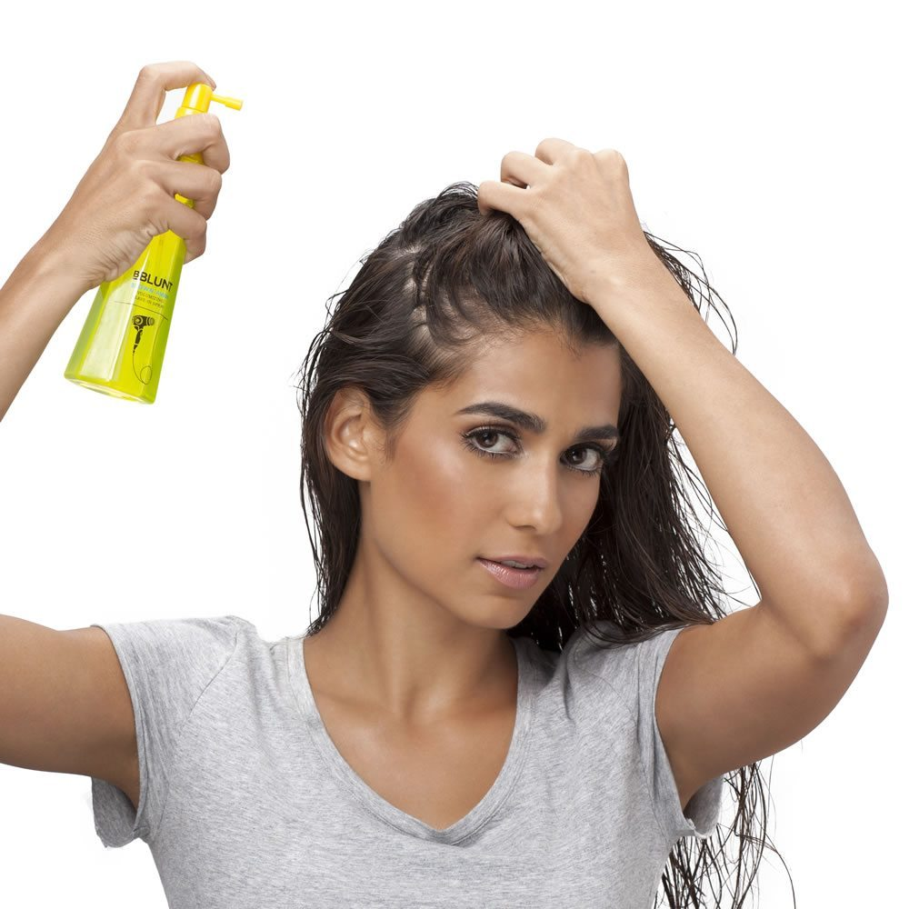Step 1 Spray BBLUNT's Blown Away Volumizing Leave-In Spray evenly all through the root area. Power dry your hair until it is relatively dry and smoothen the ends of your hair with a paddle brush. This will give the crown of your hair the much needed volume it needs.