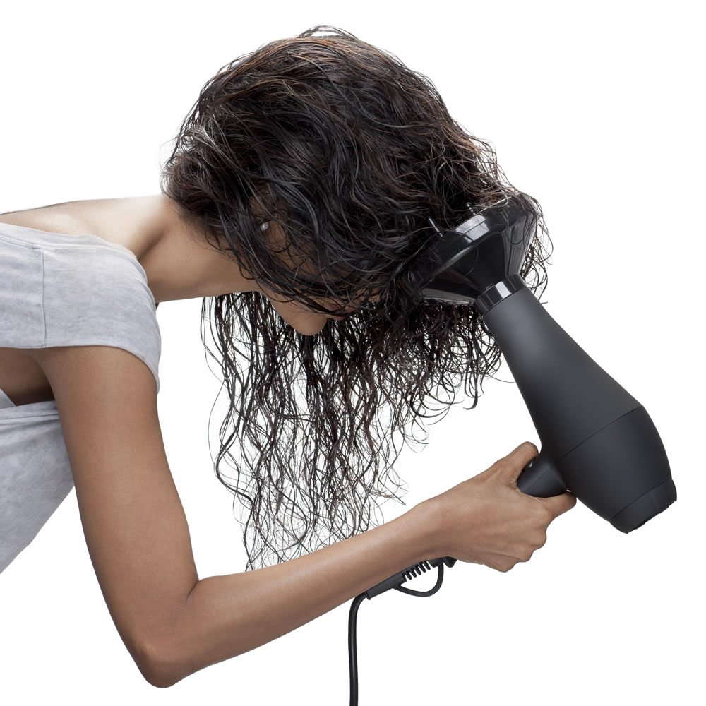 Step 3 Flip your hair upside down and attach the diffuser to the BLUNT's iR Professional Hair Dryer. Keep the setting on slow speed and medium heat. Gather the lengths of your hair into the diffuser and dry hair section by section. This way, your curls will look more natural and less frizzy.