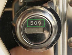 Closeup of lock tumbler showing the number highlighted