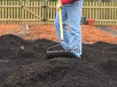 Raking in Biochar for Veggie Garden