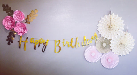 Gold and pink floral party decorations