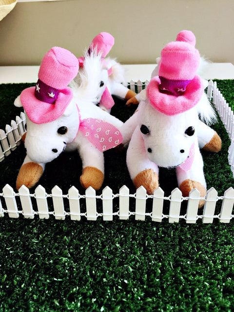 Cowgirl party supplies toy horses in pens table centrepiece