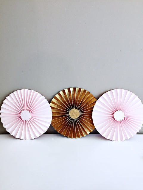 Pink and gold honeycomb fans