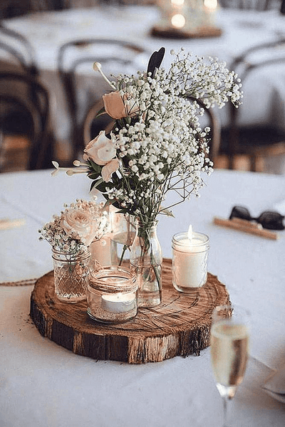 white flower with candle