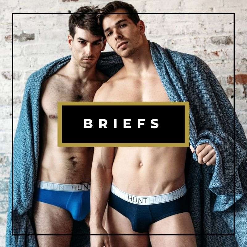 Two male models wearing briefs and wrapped in a blanket, men's underwear