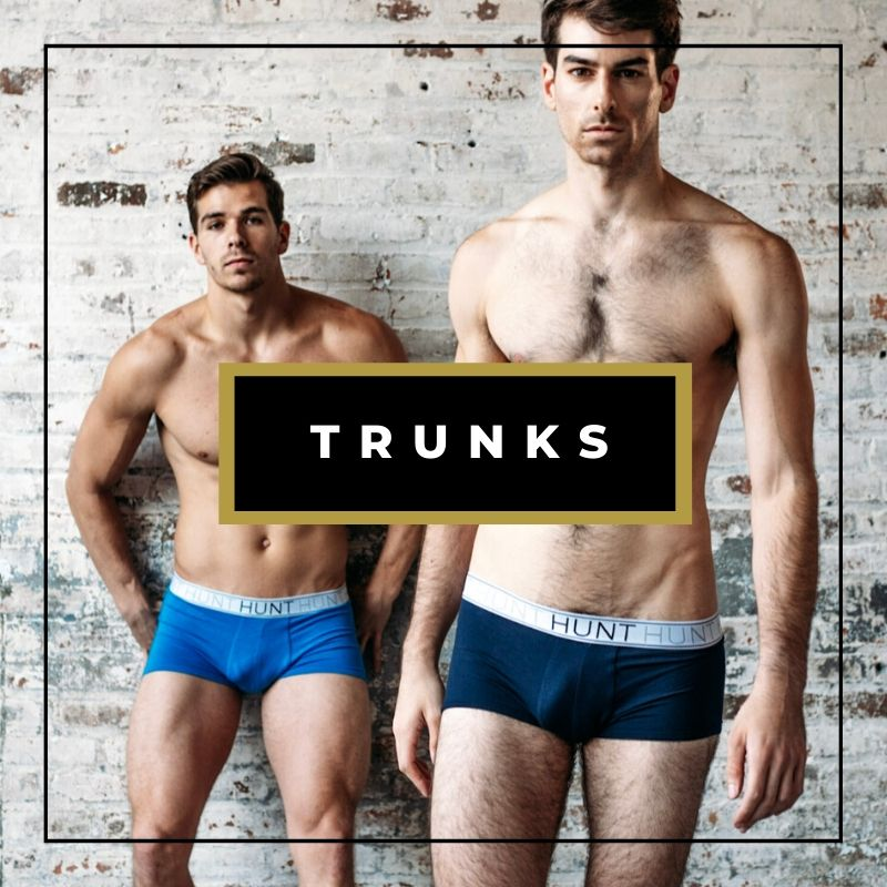 Two male models in underwear standing in front of a brick wall, comfortable men's underwear trunks
