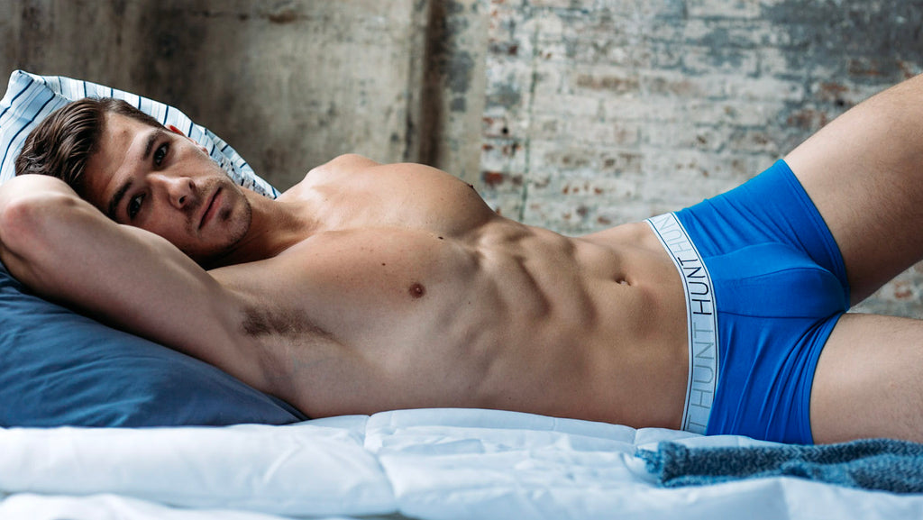 male underwear model laying on bed, Hunt Underwear
