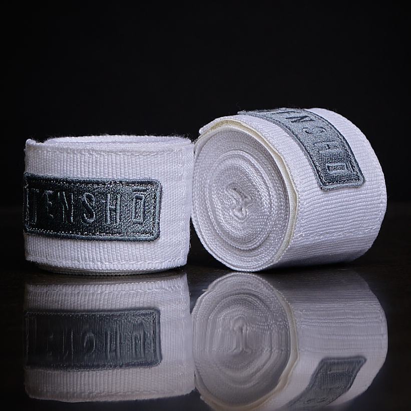 "Tensho Hand Wraps Stretchable 180"" hand wraps allow for optimal protection and comfort while boxing. 50% nylon, 50% polyester. Machine washable."