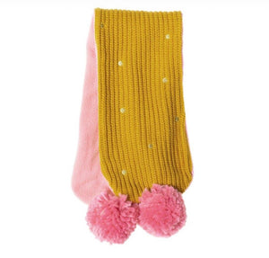 This cheery knitted scarf will brighten up any dull day! In soft knitted yellow ochre yarn with gold embroidered spots and a jolly pink pom pom on each end, it also has a cosy fleece lining for extra warmth. Age 3-6yrs.  Matching hat and mittens available.  (Not suitable for children under 36 months due to small parts)  By Rockahula