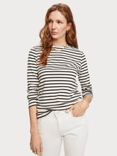 Load image into Gallery viewer, A long-sleeved t-shirt featuring classic Breton stripes. The tee is made with a crew neck, zipper detail at the left shoulder, and small logo details. By Maison Scotch