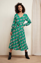 Load image into Gallery viewer, Flowing dress with V neck, waist belt and long sleeves. Danira Dress has a split down the side of the dress. By Fabienne Chapot