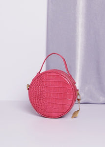 Fabienne Chapot Roundy Bag Pink.  A round pink leather crocodile print bag with short handle and adjustable long handle.