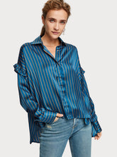 Load image into Gallery viewer, Boxy fit shirt in blue soft satin sheen fabric with contrast stripe and fine ruffle details at the shoulder. By Maison Scotch