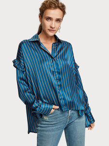 Boxy fit shirt in blue soft satin sheen fabric with contrast stripe and fine ruffle details at the shoulder. By Maison Scotch