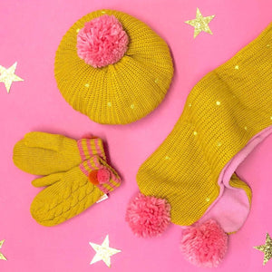 This cheery knitted beret will brighten up any dull day! In soft knitted yellow ochre yarn, with gold embroidered spots and a jolly pink pom pom on top, it also has a cosy fleece lining for extra warmth. Age 3-6yrs. Matching scarf and mittens available.  (Not suitable for children under 36 months due to small parts) By Rockahula