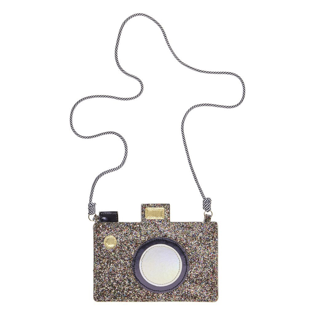 Fun glittery camera bag, with lovely details such as holographic lens and gold buttons.  This bag has a zip top closure and long black and white stripy bungee cord strap.  Get ready to strike a pose! By Mimi & Lula  Strap length 48cm (not suitable for children under 36mths)
