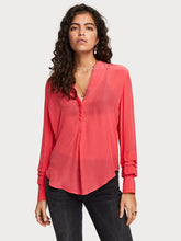 Load image into Gallery viewer, Crafted in flowy chiffon, this simple top features a blend button neckline, round hem, and layered detailing at the sleeves. By Maison Scotch