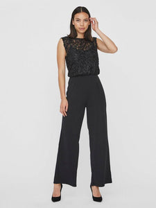 Beautiful jumpsuit with glittery upper part and loose legs.  Soft and heavy weight feel.  Style this jumpsuit with heeled shoes for the perfect party outfit.  By Vero Moda