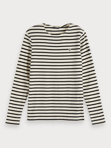 A long-sleeved t-shirt featuring classic Breton stripes. The tee is made with a crew neck, zipper detail at the left shoulder, and small logo details. By Maison Scotch