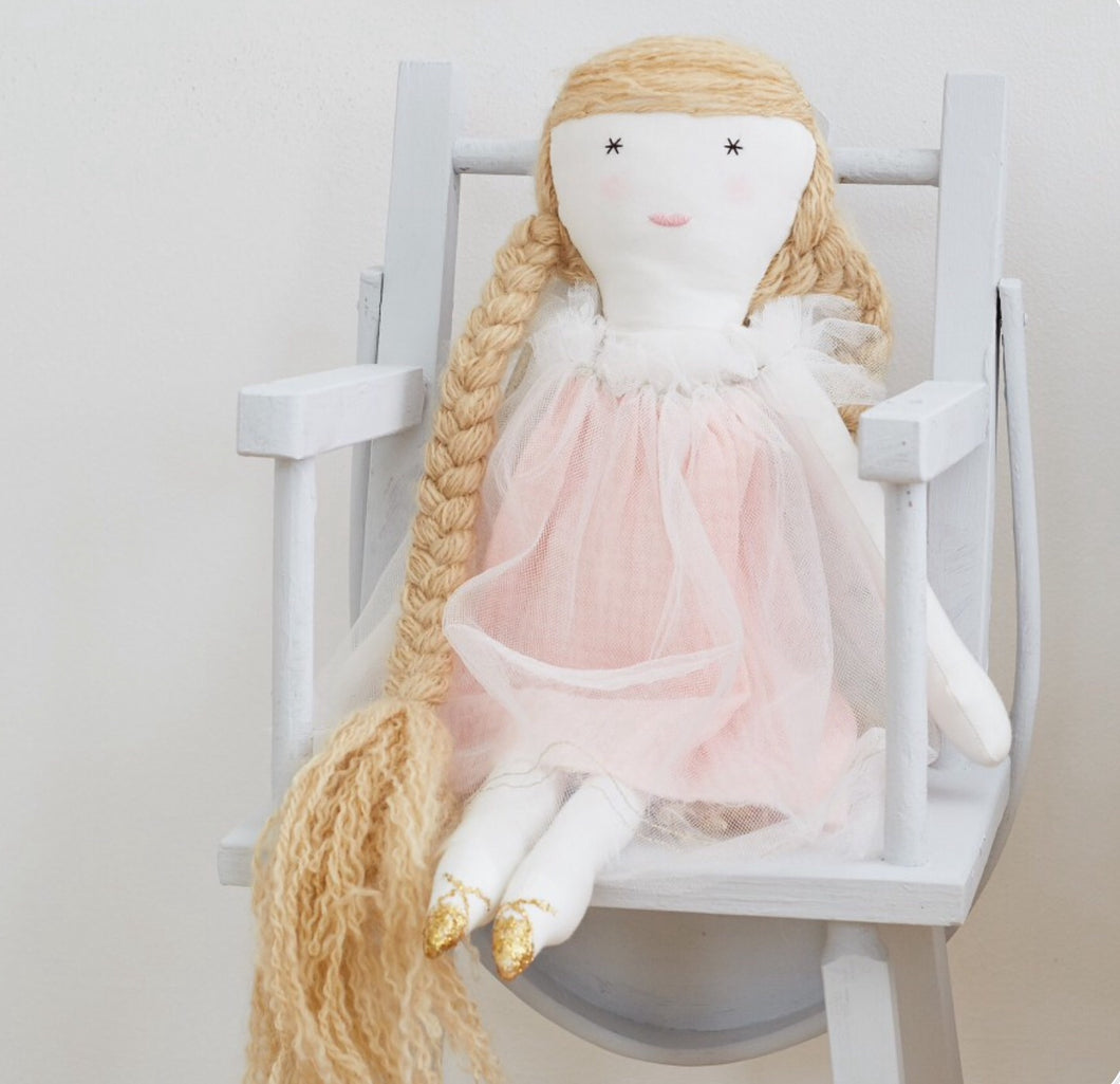 A beautiful soft fabric handmade doll.  Our fairy tale doll wears a pale pink cotton slub dress with an overlay of net that's tied with a gold ribbon with pink tassels and has gold highlights. She also has gold shoes and a gold hairband.  And that amazing hair.... the braids are 28cm long.  By Albetta