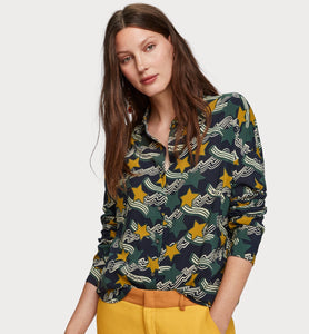 Crafted in a soft cotton-viscose blend, this oversized shirt features seasonal prints   in green with a mustard star.  The drop shoulders give a relaxed fit.  By Maison Scotch