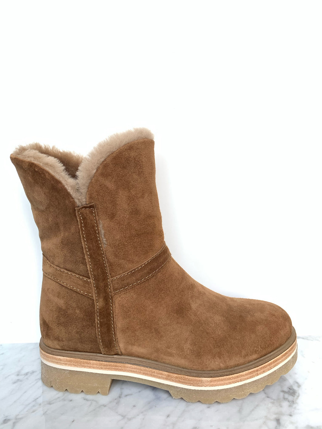 Tan nubuck leather biker style boot with fur lining and chunky sole. By Alpe