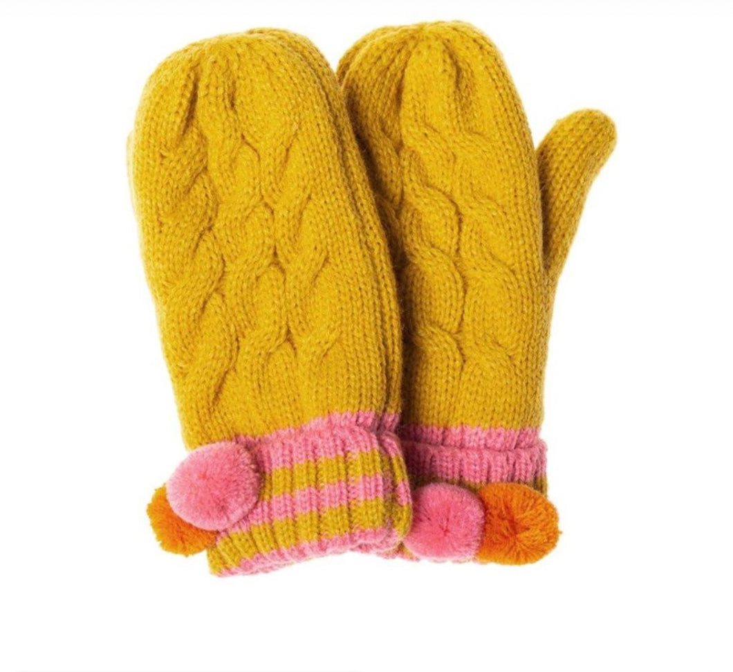 These gorgeous knitted mitts with fleece pink lining for extra warmth will brighten up any dull day. In soft knitted yellow ochre yarn and fun pom poms on turn back cuffs they are the perfect winter accessory.  Age 3 - 6 years. Can be bought with matching hat and scarf. (not suitable for children under 36 months due to small parts)  By Rockahula
