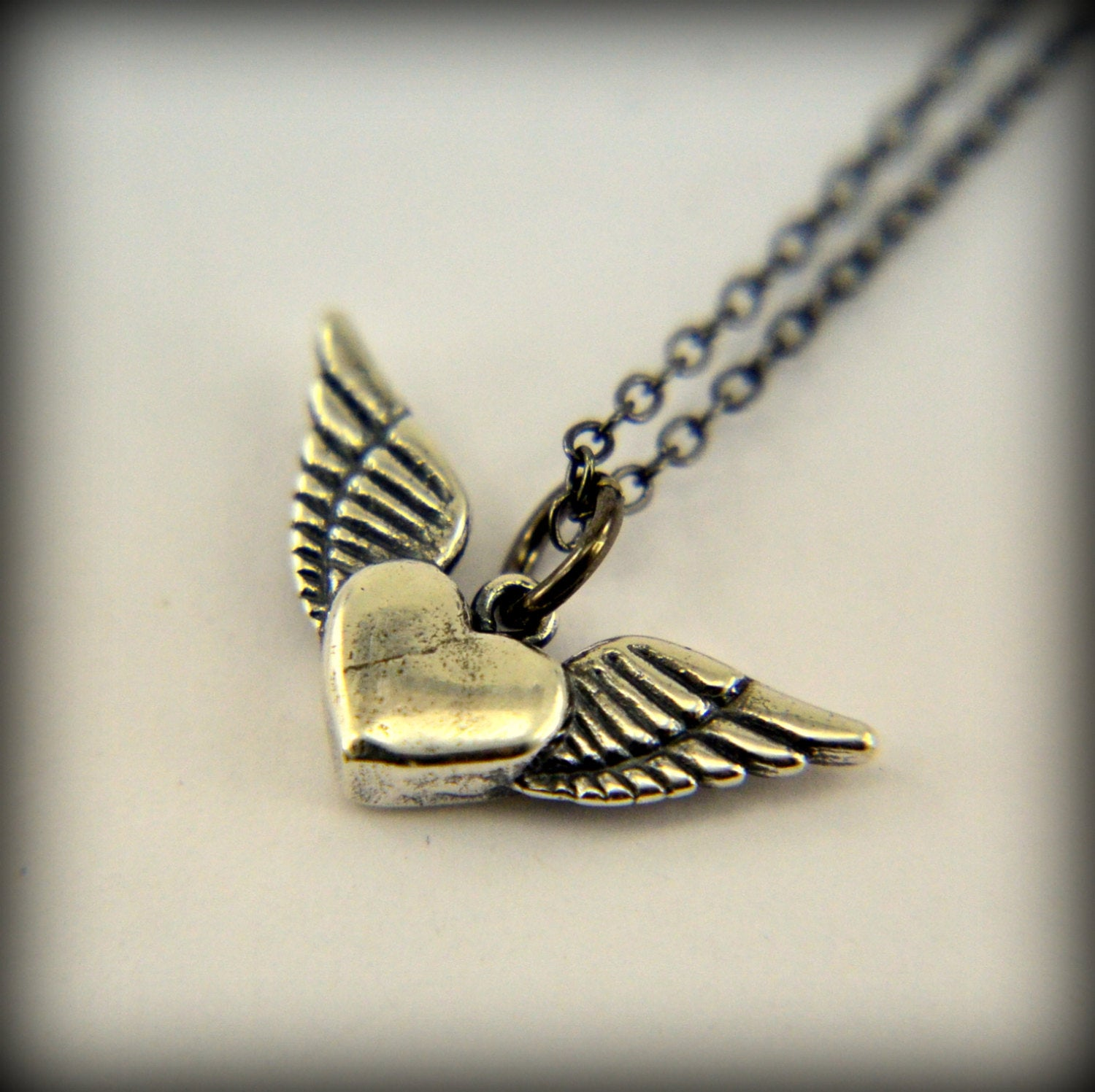 necklace pendant july winged badger bird baird products