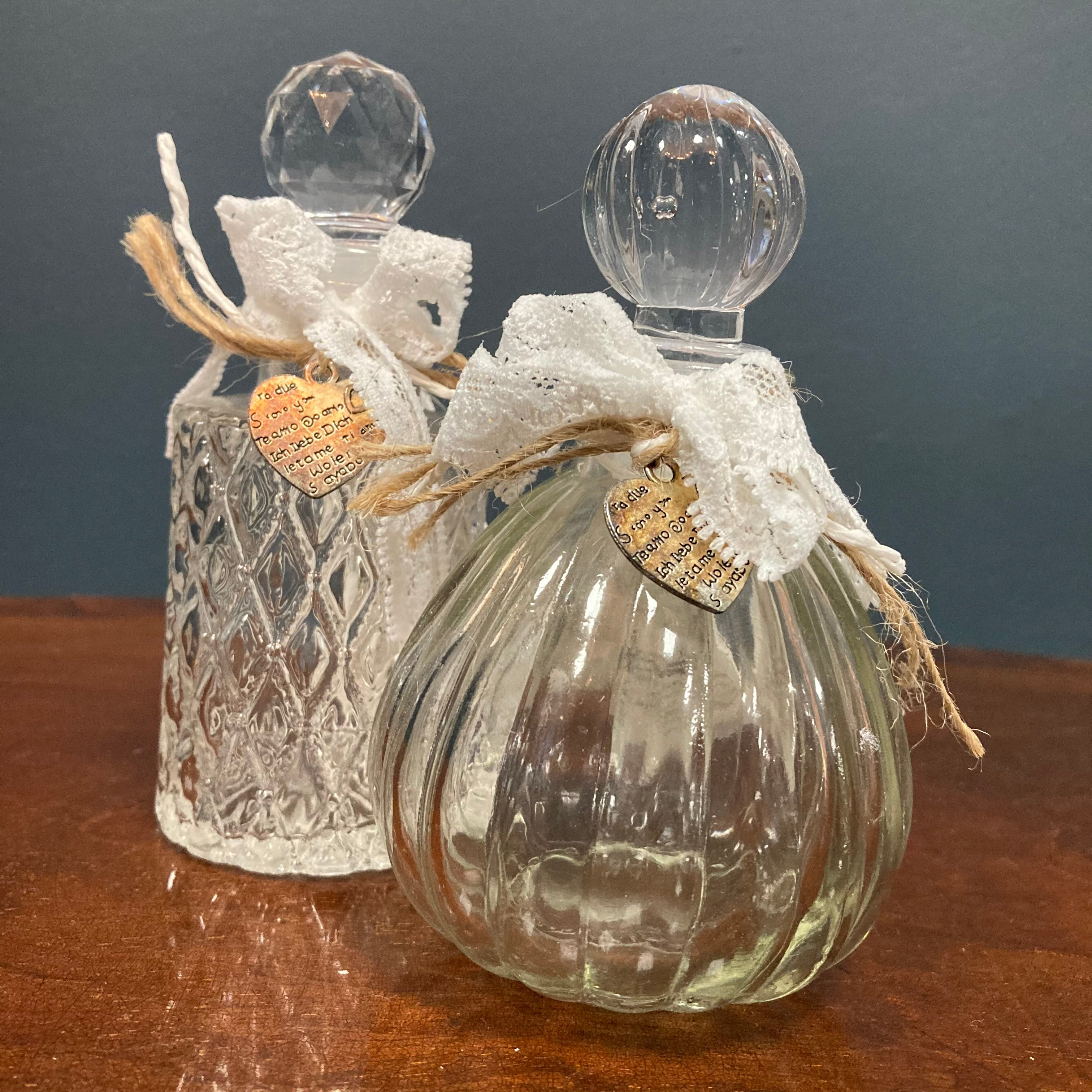 Ribbed perfume bottle with lace ribbon
