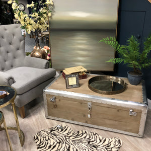 Silver trim studded trunk coffee table