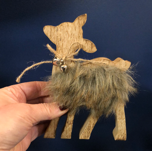 Wooden reindeer with fluffy body and bell
