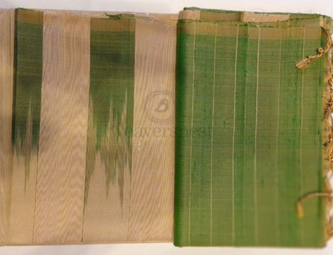 Cream raw silk saree with henna green border and pallu