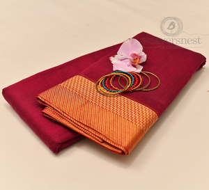 Maroon kota cotton saree with bright orange border