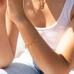 Tiny gold disc bracelet