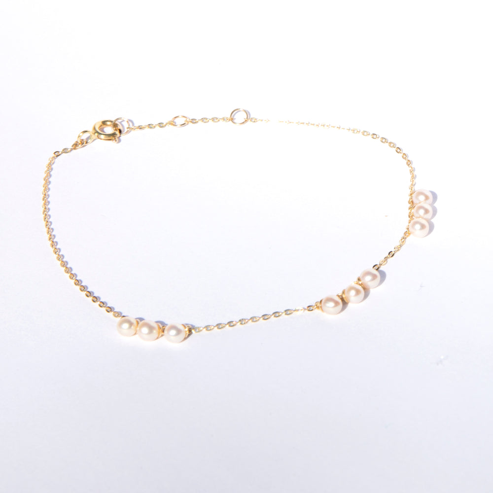 9ct gold pearl charm bracelet