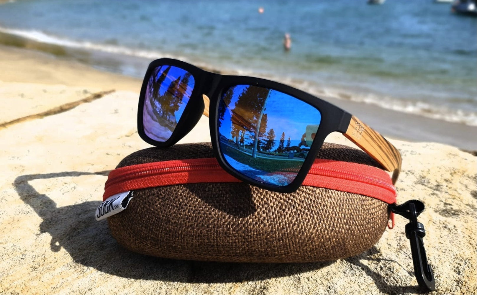 sunglasses on a case at the beach
