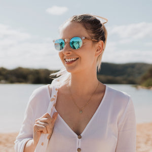 WINEGLASS BAY - Clear Framed Sustainable Sunglasses with Walnut Wooden Arms and Blue Polarized Lens - Adult
