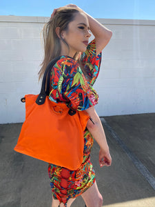 the bright orange bag