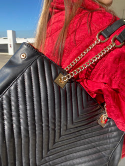black foamy handbag