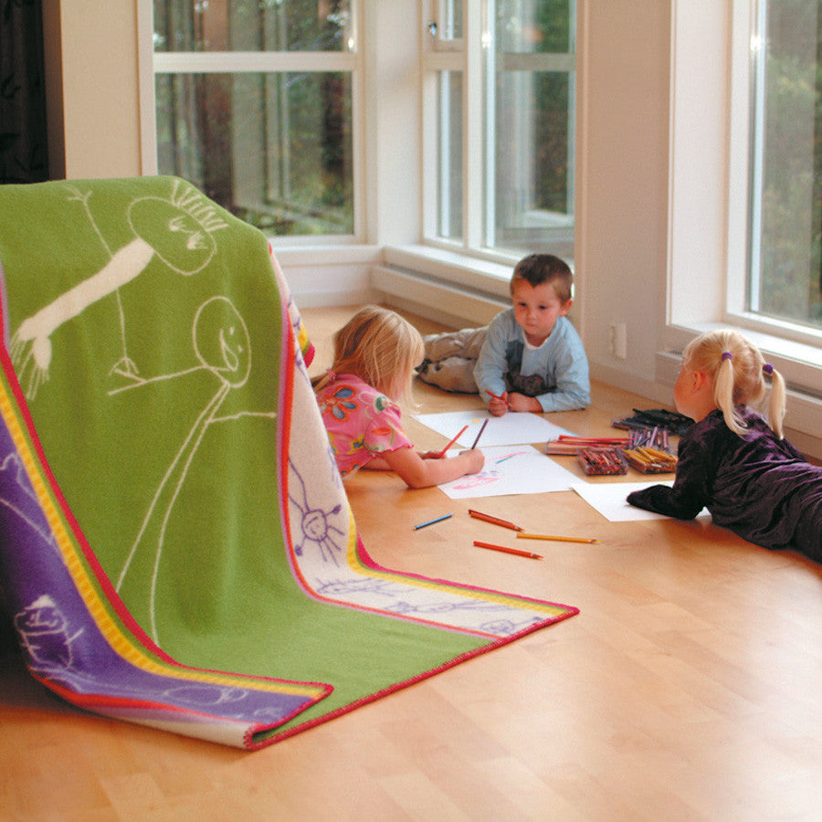 The Roros Tweed stick figure themed Framtid wool blanket's design is perfectly sized and very appealing to kids of all ages.