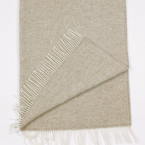 The Kattefot Norwegian wool blanket or throw pleases everyone who sees them while the neutral color fits into any décor.