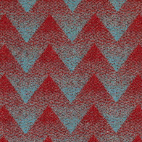 The Lynild wool blanket's pattern, shown here in Red/Blue makes one think of a peaceful mountains and valleys scene.