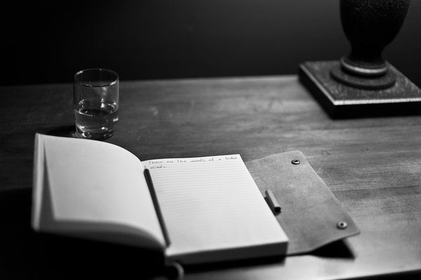 A black and white photo of a manuscript writing notepad