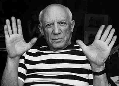 A black and white photo of pablo picasso showing his hands