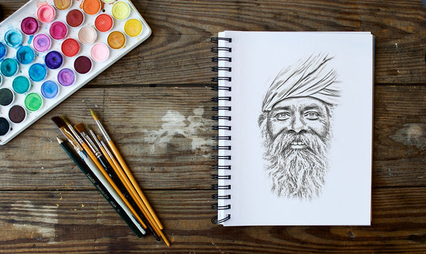 A drawing portrait pencil face of an Indian man